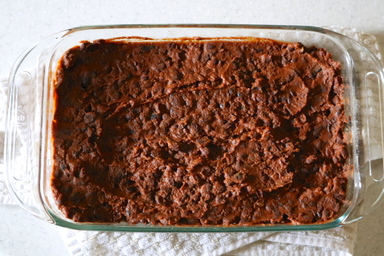 Black Bean & Potato Breakfast Casserole | A hearty breakfast casserole with layers of roasted potatoes, seasoned black beans, greens, eggs, and dairy free cheese. Omit eggs for vegan option. | eatsomethingdelicious.com